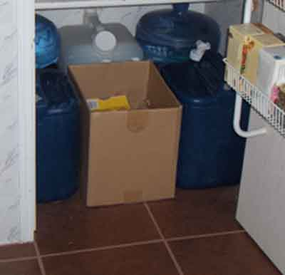 Our water storage shares the bottom of the kitchen pantry with our cardboard recycling.