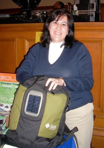 woman holding a backpack with a solar panel
