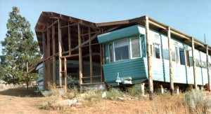 Kelly built a roof and large living room over two long single-wide travel trailers that we got for a song.